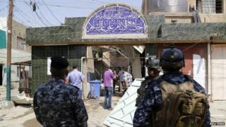 Troops outside Shia mosque in New Baghdad that was targeted by a suicide bomber (25 August 2014)