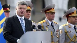 President Petro Poroshenko (left) speaks during an Independence Day parade in Kiev. Photo: 24 August 2014