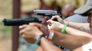 Shooters practice with pistols at a gun range