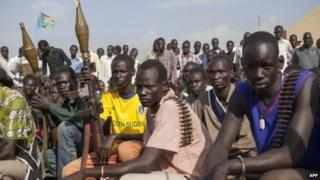 """Members of the """"white army"""", a militia that is part of the rebel alliance loyal to Riak Machar, pictured in Nasir, South Sudan - April 2014"""
