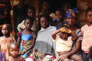 Fatoumata Kone, centre, with her family in the village of Sipilou - 27 August 2014