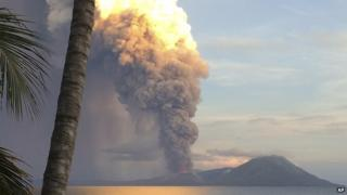 In this photo taken and released by Jason Tassell, a huge smoke billows from Mt. Tavurvu after an eruption in Kokopo, east New Britain, Papua New Guinea, on Friday, 29 August 2014
