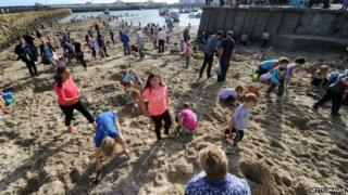 Digging for gold on Folkestone beach