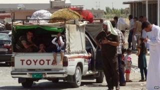 Displaced Shia Kurds from the Mosul area on the Kirkuk-Irbil road - 8 August