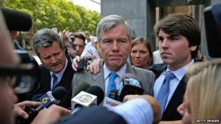 Former Virginia Governor Bob McDonnell (C) leaves his trial at U.S. District Court with his son Bobby (R) 28 August 2014