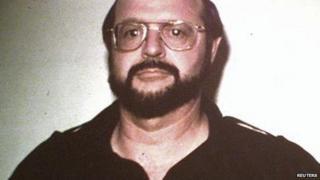 A booking mugshot by the FBI shows John Arthur Walker, Jr. after his arrest in 1985