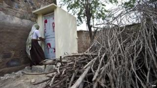 Indian village resident Geeta uses a toilet constructed by the Sulabh International NGO in the Hirmathala village of Mewat district in the state of Haryana.