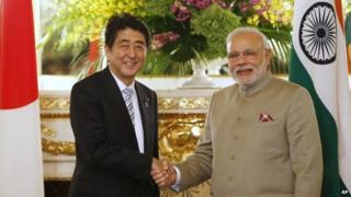 Indian PM Narendra Modi and Japan's PM Shinzo Abe shake hands before their talks at the state guest house in Tokyo Monday, Sept. 1, 2014