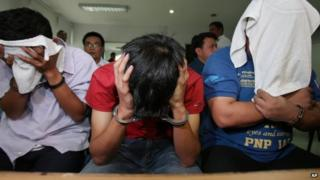 Members of a group who call themselves 'USAFE', wait for inquest proceedings at the Department of Justice in Manila, Philippines on Tuesday, 2 September 2014