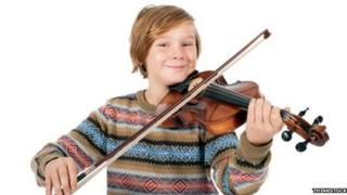 Boy plays violin