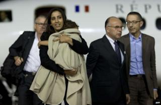 Meriam Rhaiem clutching her baby at Villacoublay air base near Paris, 3 September