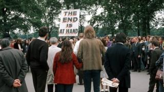 A man with a sign saying THE END IS AT HAND talks to the crowd at Speakers' Corner, Hyde Park, London on 11 June 1972.