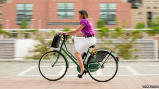 A woman cycling to work