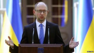 File photo: Ukraine's Prime Minister Arseniy Yatseniuk speaks to the media in Kiev, 31 July 2014