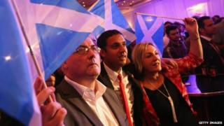 """""""Better Together"""" supporters celebrate the result of the Scottish referendum on independence at the campaign headquarters on 19 September 2014 in Glasgow, Scotland"""