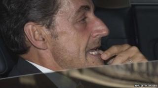 Former French president Nicolas Sarkozy in his car in Paris on 19 September 2014