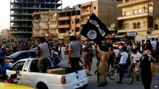 Islamic State militants in Raqqa (file photo)
