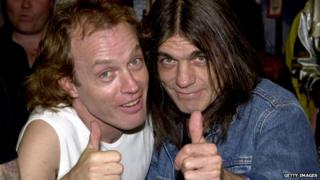 Angus Young and brother Malcolm Young of the Australian rock band AC-DC