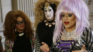 In this Sept. 17, 2014 file photo, drag queens from left, Lil Ms. Hot Mess, Sister Roma and Heklina, take turns speaking about their battle with Facebook during a news conference at City Hall in San Francisco, Calif.