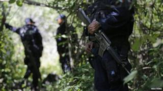 Police guard clandestine graves found in Iguala Guerrero state 9 October 2014