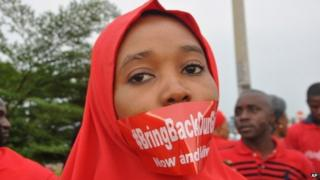 A woman attends a demonstration in Abuja, Nigeria, on 11 September 2014, calling on the government to rescue the kidnapped girls of the government secondary school in Chibok.
