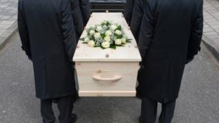 Pallbearers and coffin