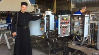 Monk at a cheese factory