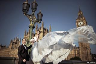 Bride and groom on Westminster Bridge