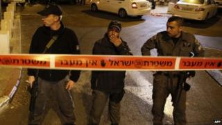 Israeli security forces stand behind a security perimeter outside the Menachem Begin Heritage Centre (29 October 2014)