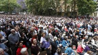 """Thousands gather in tribute to former Australian Prime Minister Gough Whitlam as they watch a live telecast of his memorial service at Sydney""""s Town Hall, November 5, 2014. Whitlam, who died on October 21 aged 98, was one of his country""""s most revolutionary yet divisive statesmen, forging ties with China but triggering a constitutional crisis that split the country."""