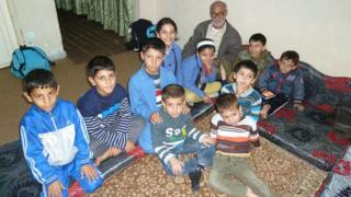 Abu Ismail Al-Hassan and some of his grandchildren