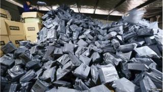 Employee sorting packages in Jiujiang, Jiangxi province, 11 November 2014