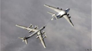 Russian Tupolev Tu-95 strategic bomber refuelling over an unknown location during a military exercise