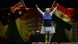 Prime Minster of India Narendra Modi acknowledges thousands of supporters at the Allphones Arena Olympic park in Sydney on November 17, 2014