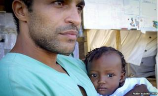 Dr Abdelmoneim with one of the children in his care