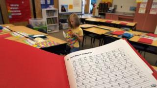 A handwriting exercise book in a classroom