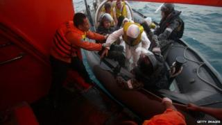 Australian navy personnel transfer Afghanistan asylum seekers to Indonesian rescue boat near West Java. 31 August 31 2012