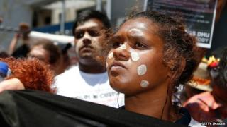 A woman attends a march to protest for aboriginal rights. Photo: November 2014