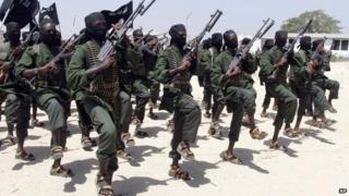 Hundreds of newly trained al-Shabab fighters perform military exercises in the Lafofe area of Somalia