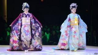 Models wearing bridal kimonos at a fashion show