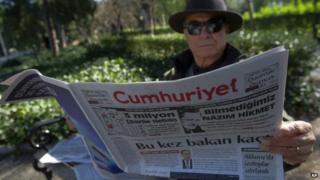 A man reads Cumhuriyet, the leading pro-secular Turkish newspaper, in Istanbul, Turkey, 14 January 2015
