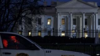 A member of the Secret Service's Uniformed Division sits in his car on Pennsylvania Avenue outside the White House January 26, 2015 in Washington, DC