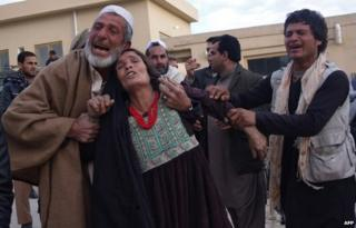 Afghan relatives weep for the victims as they arrive at the hospital following a suicide attack which targeted funeral prayers in Mehtar Lam city, of Laghman province on January 29