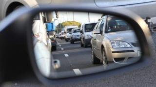Traffic jam in wing mirror