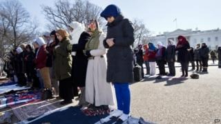 Fatima Chrifi, a teacher at Georgetown University, centre, prays with a group of Muslims and their supporters during Friday prayers outside the White House in Washington, Friday, Feb. 13, 2015, in the wake of the murder of three young North Carolina Muslims.