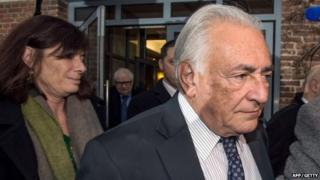 Former IMF chief Dominique Strauss-Kahn (C), flanked by his lawyer Frederique Beaulieu (L), leaves his hotel on February 17, 2015 in Lille, France