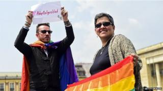 Activists protests outside the Supreme Court of Justice in Bogota demanding the legalisation of the adoption of children by same-sex couples on 18 February, 2015.