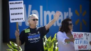 Walmart protestors holding sign