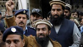 Zaki-ur-Rahman Lakhvi, the main suspect of the Mumbai terror attacks in 2008, raises his fist after his court appearance in Islamabad, Pakistan, Thursday, 1 Jan 2015.