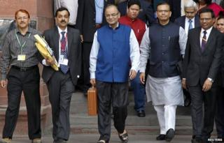 "India""s Finance Minister Arun Jaitley (C) leaves his office to present the 2015/16 federal budget in New Delhi February 28, 2015."
